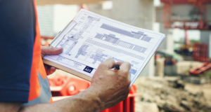 Construction Site Engineer Working Blueprint | property condition assessment raleigh